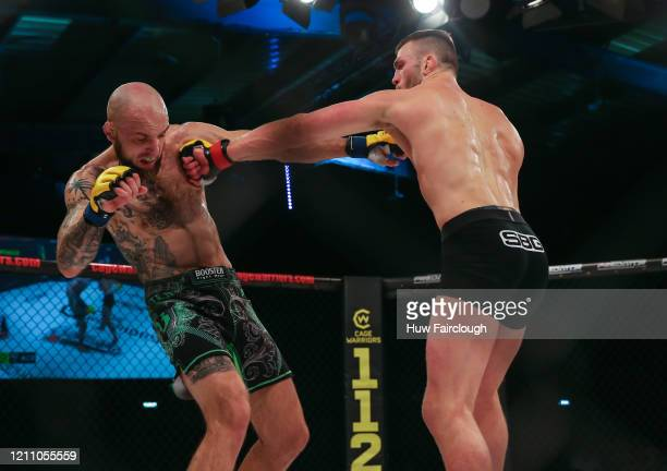 Adam Proctor and Madars Fleminas battling it out during their welterweight contest during Cage Warriors 112 on March 7 2020 in Manchester England