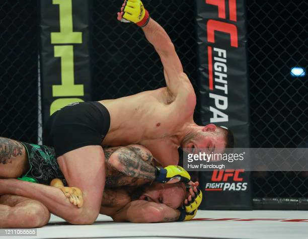 Adam Proctor Throw punches down on Madars Fleminas during their welterweight contest during Cage Warriors 112 on March 7 2020 in Manchester England
