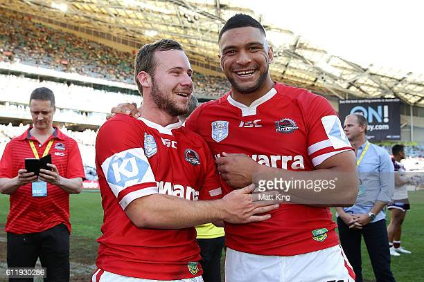 Adam Quinlan and Taane Milne of the Cutters celebrate winning the 2016 State Championship Grand Final match between the Illawarra Cutters and the...