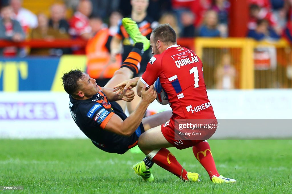 Adam Quinlan of Hull KR pushes off Greg Eden of Castleford Tigers during the Roger Millward Trophy match between Hull KR and Castleford Tigers as part of the Betfred Super League at KCOM Stadium on June 1, 2018 in Hull, England.