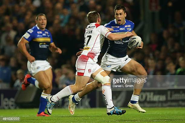 Adam Quinlan of St Helens RFC attempts to tackle Joel Moon of Leeds Rhinos during the First Utility Super League Semi Final between Leeds Rhinos and...