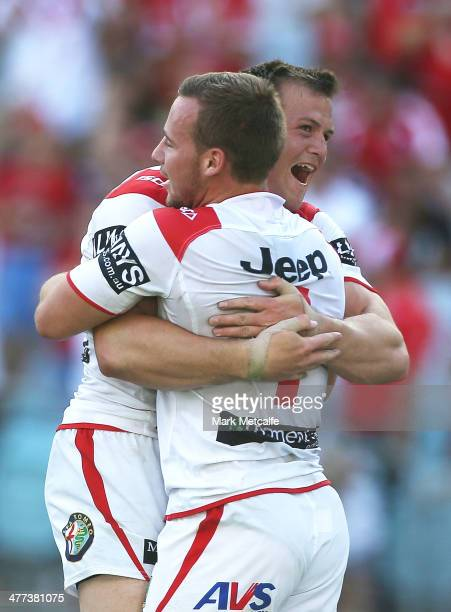 Adam Quinlan of the Dragons celebrates scoring a try with team mate Brett Morris during the round one NRL match between the St George Illawarra...