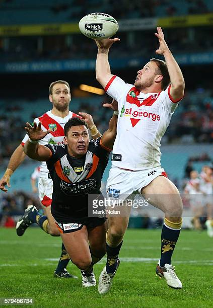 Adam Quinlan of the Dragons juggles the ball to score a try during the round 20 NRL match between the St George Illawarra Dragons and the Wests...