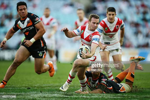 Adam Quinlan of the Dragons makes a break during the round 20 NRL match between the Wests Tigers and the St George Illawarra Dragons at ANZ Stadium...