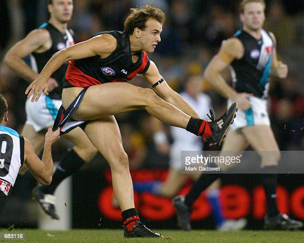 Adam Ramanauskas for the Bombers almost loses his shorts in a tackle by Matthew Bishop for Port Adelaide during the Round 11 Essendon Bombers versus...