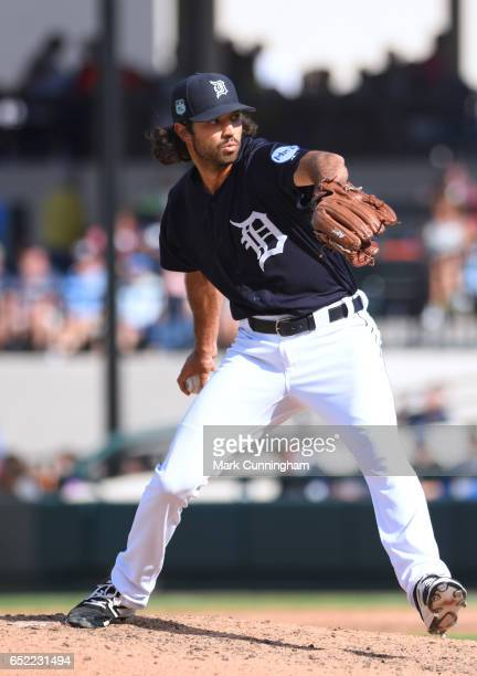 Adam Ravenelle of the Detroit Tigers pitches during the Spring Training game against the New York Yankees at Publix Field at Joker Marchant Stadium...