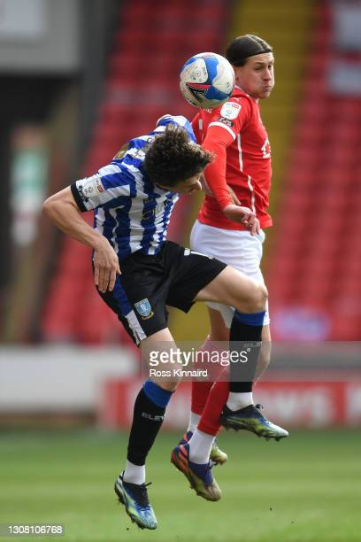Adam Reach of Sheffield Wednesday and Callum Brittain of Barnsley FC contest a header during the Sky Bet Championship match between Barnsley and...