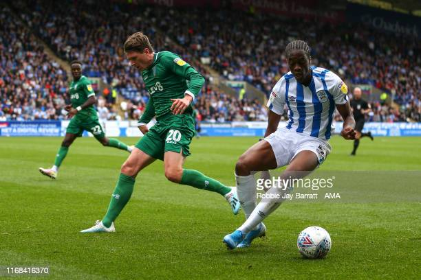 Adam Reach of Sheffield Wednesday and Terence Kongolo of Huddersfield Town during the Sky Bet Championship match between Huddersfield Town and...