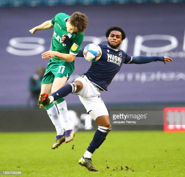 Adam Reach of Sheffield Wednesday battles for possession with Mahlon Romeo of Millwall FC during the Sky Bet Championship match between Millwall and...
