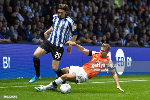Adam Reach of Sheffield Wednesday battles for the ball with James Bree of Luton Town during the Sky Bet Championship match between Sheffield...