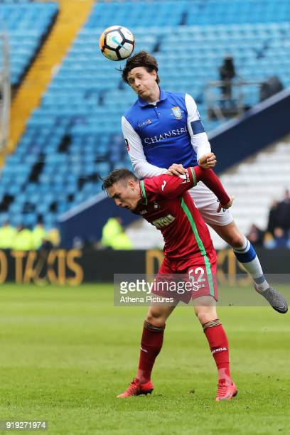 Adam Reach of Sheffield Wednesday heads the ball over Connor Roberts of Swansea City during The Emirates FA Cup Fifth Round match between Sheffield...