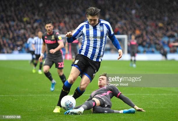 Adam Reach of Sheffield Wednesday is tackled by Ezgjan Alioski of Leeds United during the Sky Bet Championship match between Sheffield Wednesday and...
