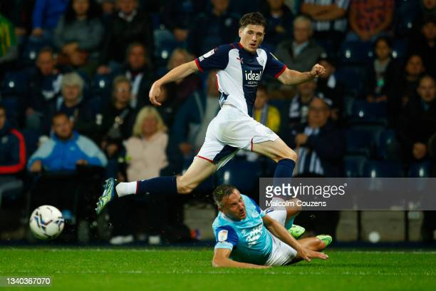 Adam Reach of West Bromwich Albion avoids a tackle from Phil Jagelka of Derby County during the Sky Bet Championship match between West Bromwich...