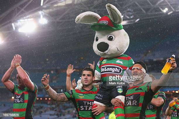 Adam Reynolds and Issac Luke of the Rabbitohs carry Charlie Gallico the Rabbitohs mascot 'Reggie' as they celebrate with the crowd after victory...