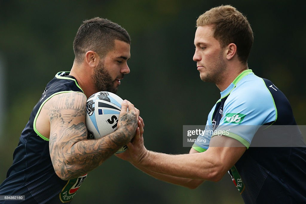 Adam Reynolds of the Blues (L) runs the ball at Matt Moylan of the Blues (R) during a New South Wales State of Origin media opportunity on May 26, 2016 in Coffs Harbour, Australia.