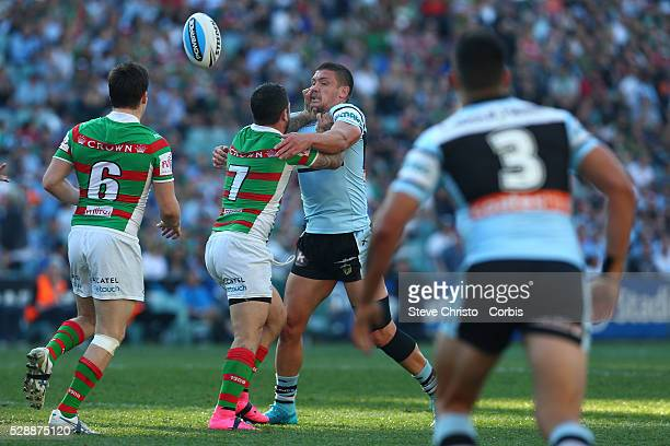 Adam Reynolds of the Rabbitohs and the Shark's Chris Heighington get into a bit of a scuffle during the Elimination Final match between South Sydney...