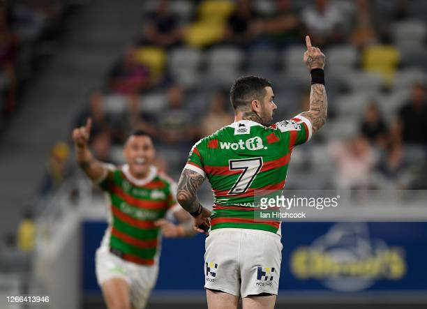 Adam Reynolds of the Rabbitohs celebrates after kicking the winning field goal during the round 14 NRL match between the North Queensland Cowboys and...