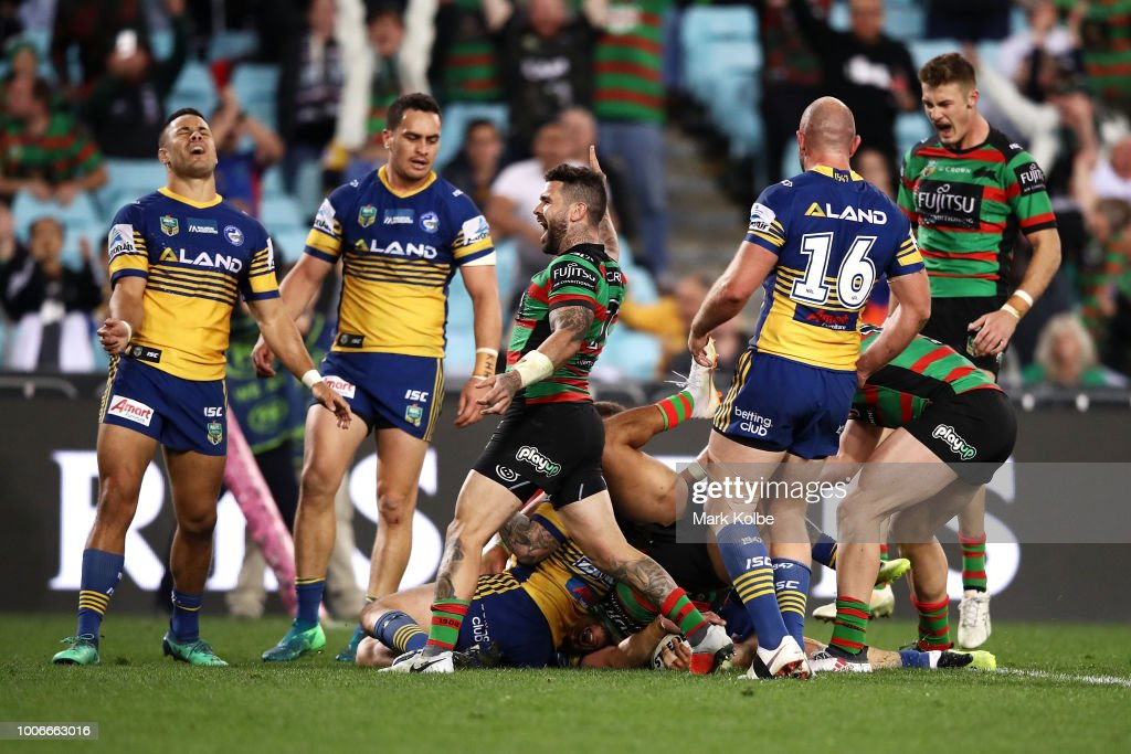Adam Reynolds of the Rabbitohs celebrates Dane Gagai scoring a try during the round 20 NRL match between the South Sydney Rabbitohs and the Parramatta Eels at ANZ Stadium on July 28, 2018 in Sydney, Australia.