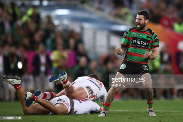 Adam Reynolds of the Rabbitohs celebrates kicking a field goal to even the scores at 1212 during the NRL Semi Final match between the South Sydney...
