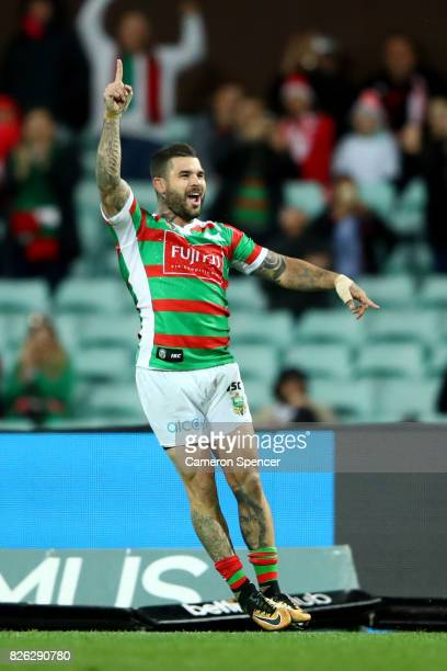 Adam Reynolds of the Rabbitohs celebrates kicking a goal during the round 22 NRL match between the St George Illawarra Dragons and the South Sydney...