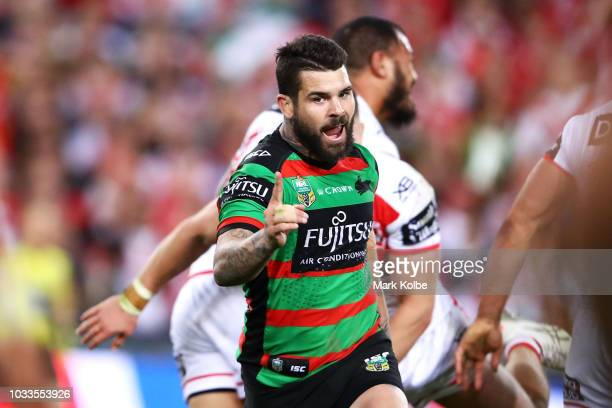 Adam Reynolds of the Rabbitohs celebrates kicking the match winning field goal during the NRL Semi Final match between the South Sydney Rabbitohs and...