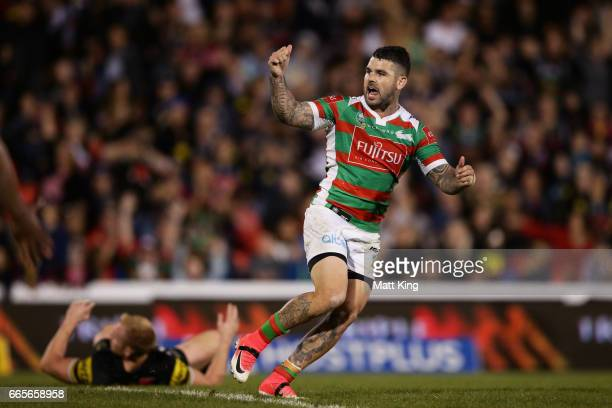 Adam Reynolds of the Rabbitohs celebrates kicking the winning field goal during the round six NRL match between the Penrith Panthers and the South...