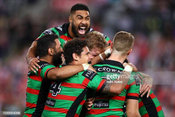 Adam Reynolds of the Rabbitohs celebrates with his team mates after kicking the match winning field goal during the NRL Semi Final match between the...