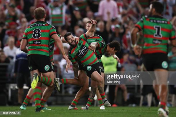 Adam Reynolds of the Rabbitohs celebrates with team mates after kicking the winning field goal during the NRL Semi Final match between the South...