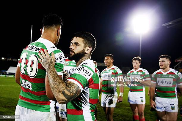 Adam Reynolds of the Rabbitohs celebrates with the team after winning the round 23 NRL match between the New Zealand Warriors and the South Sydney...