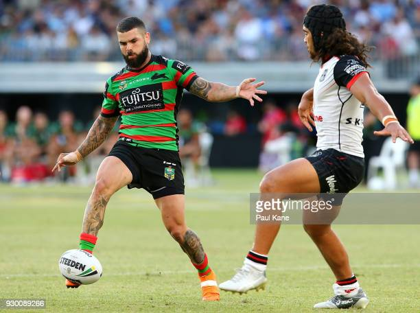 Adam Reynolds of the Rabbitohs chips the ball during the round one NRL match between the South Sydney Rabbitohs and the New Zealand Warriors at Optus...