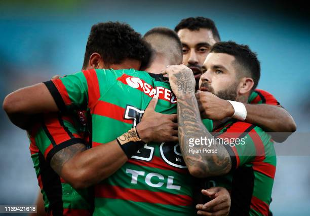 Adam Reynolds of the Rabbitohs congratulates Corey Allan of the Rabbitohs after he scores a try during the round three NRL match between the South...