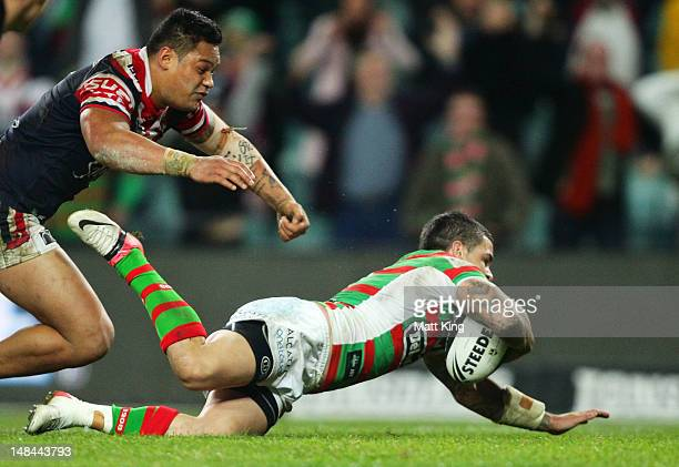 Adam Reynolds of the Rabbitohs dives over to score the match winning try in the final seconds during the round 19 NRL match between the Sydney...