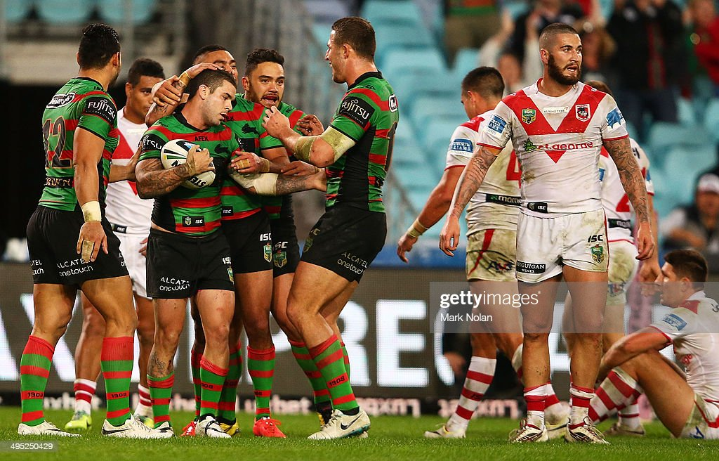 Adam Reynolds of the Rabbitohs is congratulated by team mates after scoring during the round 12 NRL match between the South Sydney Rabbitohs and the St George Illawarra Dragons at ANZ Stadium on June 2, 2014 in Sydney, Australia.