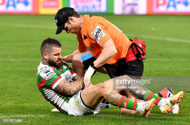 Adam Reynolds of the Rabbitohs is injured during the round 23 NRL match between the Brisbane Broncos and the South Sydney Rabbitohs at Suncorp...