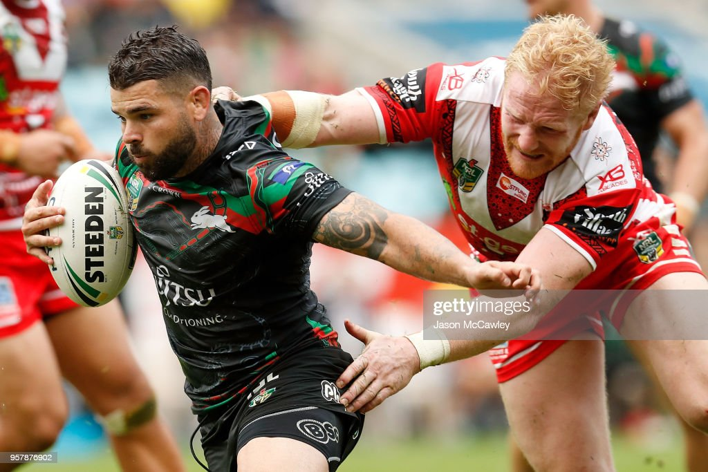 Adam Reynolds of the Rabbitohs is tackled by James Graham of the Dragons during the round 10 NRL match between the South Sydney Rabbitohs and the St George Illawarra Dragons at ANZ Stadium on May 13, 2018 in Sydney, Australia.