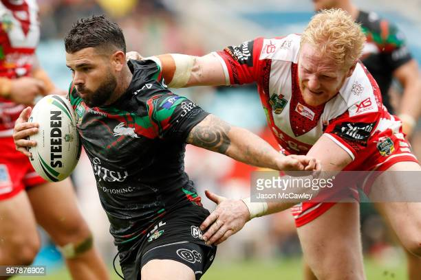 Adam Reynolds of the Rabbitohs is tackled by James Graham of the Dragons during the round 10 NRL match between the South Sydney Rabbitohs and the St...