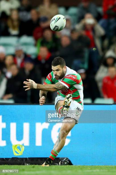 Adam Reynolds of the Rabbitohs kicks a goal during the round 22 NRL match between the St George Illawarra Dragons and the South Sydney Rabbitohs at...