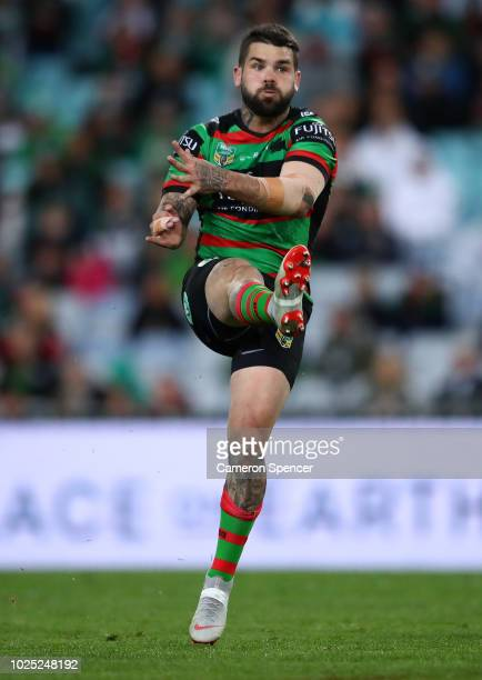 Adam Reynolds of the Rabbitohs kicks during the round 25 NRL match between the South Sydney Rabbitohs and the Wests Tigers at ANZ Stadium on August...
