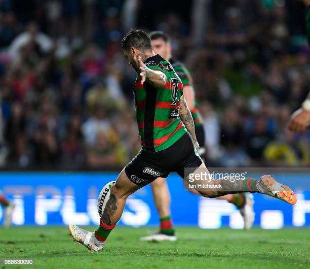 Adam Reynolds of the Rabbitohs kicks the winning field goal during the round 16 NRL match between the South Sydney Rabbitohs and the North Queensland...