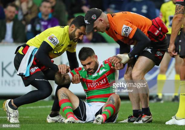 Adam Reynolds of the Rabbitohs leaves the field injured during the round 25 NRL match between the Melbourne Storm and the South Sydney Rabbitohs at...