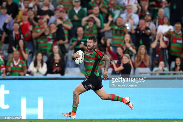 Adam Reynolds of the Rabbitohs makes a break to score a try during the round eight NRL match between the South Sydney Rabbitohs and the Brisbane...