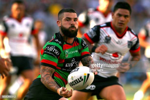 Adam Reynolds of the Rabbitohs passes the ball during the round one NRL match between the South Sydney Rabbitohs and the New Zealand Warriors at...