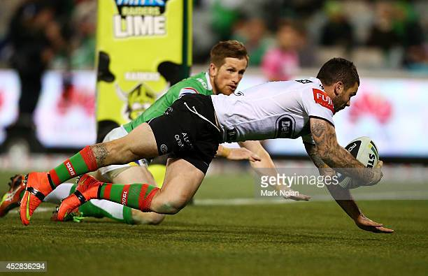 Adam Reynolds of the Rabbitohs scores a try during the round 20 NRL match between the Canberra Raiders and the South Sydney Rabbitohs at GIO Stadium...
