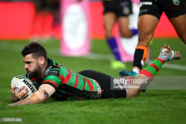 Adam Reynolds of the Rabbitohs scores a try during the round 25 NRL match between the South Sydney Rabbitohs and the Wests Tigers at ANZ Stadium on...