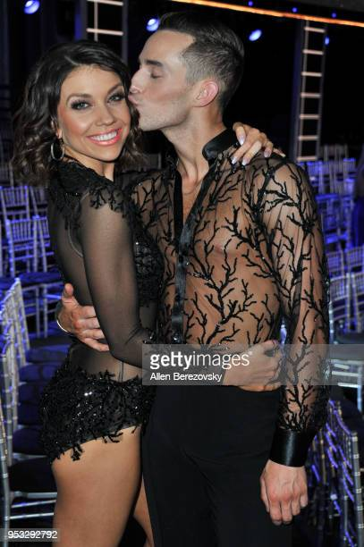 Adam Rippon and Jenna Johnson attend ABC's 'Dancing With The Stars Athletes' Season 26 show on April 30 2018 in Los Angeles California