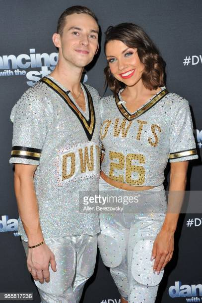 Adam Rippon and Jenna Johnson attend ABC's 'Dancing With The Stars Athletes' Season 26 show on May 7 2018 in Los Angeles California