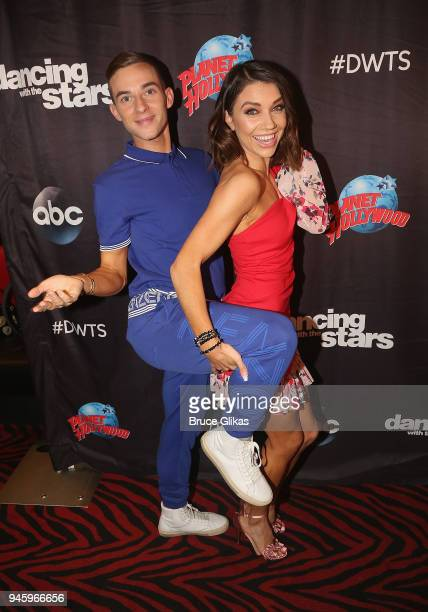 Adam Rippon and Jenna Johnson pose as the 'Dancing with the Stars Athletes Season 26' cast visits Planet Hollywood Times Square on April 13 2018 in...