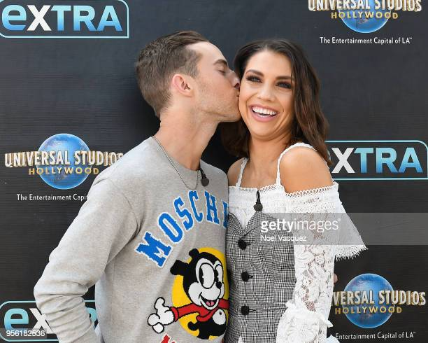 Adam Rippon and Jenna Johnson visit 'Extra' at Universal Studios Hollywood on May 8 2018 in Universal City California