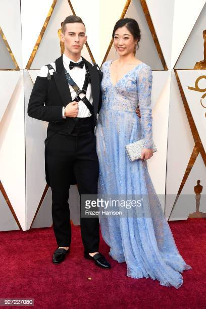 Adam Rippon and Mirai Nagasu attend the 90th Annual Academy Awards at Hollywood Highland Center on March 4 2018 in Hollywood California
