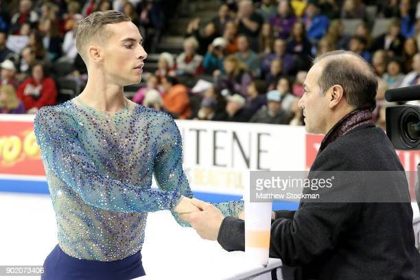 Adam Rippon confers with coach Rafael Arutunian before skating in the Men's Free Skate during the 2018 Prudential US Figure Skating Championships at...